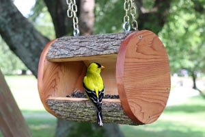 DIY homemade wooden bird feeder plans using a recycled or natural log.