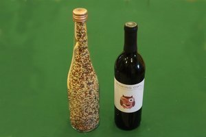 Homemade bird feeder wine bottle