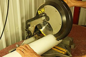 Cutting PVC with a miter saw.