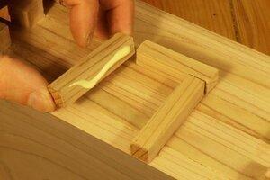 Attach the door using glue.