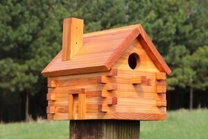 Free log cabin style bird house plans with patterns.