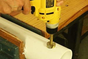 Drilling hole for feeder tube using a Forsnter drill bit.