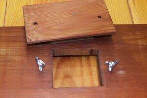 Cleanout door bolts wood.