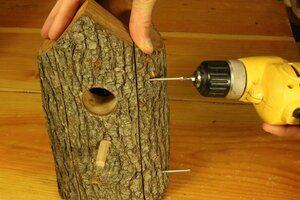 Assemble the pieces of the bird house using screws.