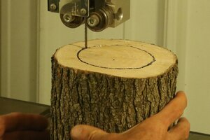 Removing the inside of the log using a band saw.
