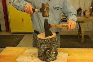Splitting log using a hatchet, axe, or shingle froe tool.