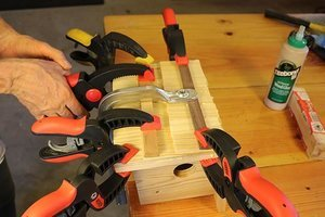 Use clamps to hold the shims in place until the glue dries.