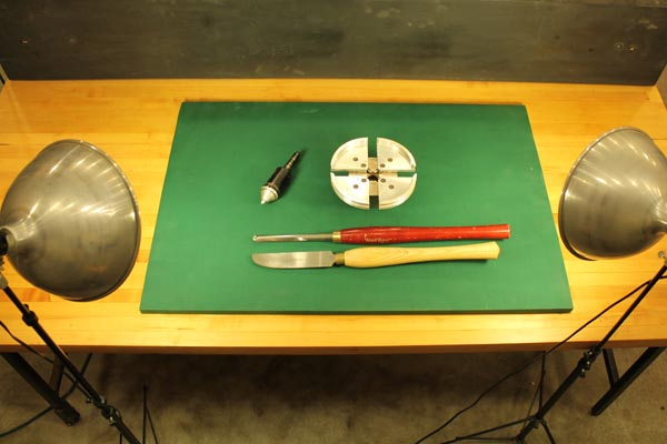 A solid green background used for photographing woodturning tools.