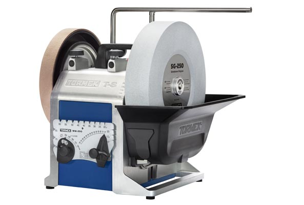 The Tormek T-8 sharpening system with a grindstone and a leather honing wheel.