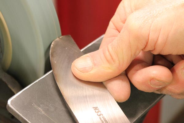 Sharpening a scraper.
