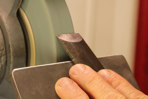 Sharpening an oval skew chisel.