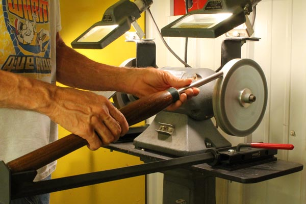 "Using a ""V"" arm attachment to sharpen a gouge."