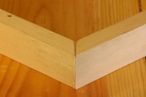 Test for gap in miter joint before assembly.
