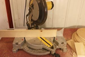 Miter saw set to 30-degree angle for hexagon wall shelf.