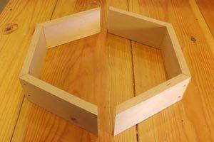 Two halves hexagon wall shelf.