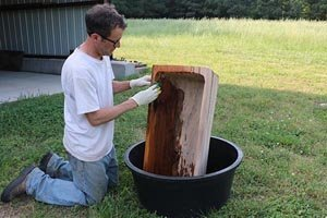 Finishing a dough bowl with linseed oil.