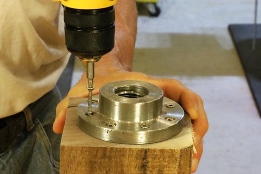 1. Attach a faceplate to a blank for mounting on a woodturing lathe.