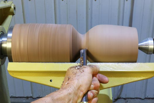 4. Shape the bowl of the goblet using a gouge.