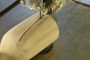 . Remove the top portion of the scoop using either a bandsaw or a disc sander.