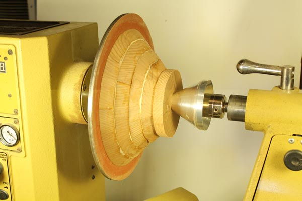 Step 6. Some woodturners clamp segmented layers together on the lathe.