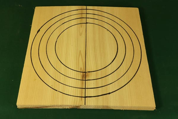 Step 1. Mark the segmented rings and cut the board in half.