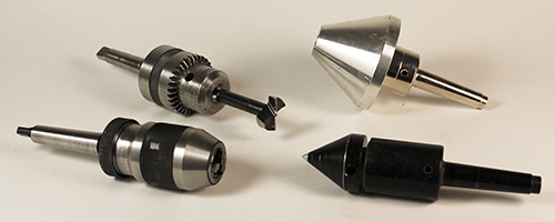 Collection of accessories with Morse tapers.