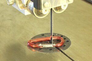 Bandsaw Tips for the beginner - a Carabiner clip around the bandsaw blade reminds me to tighten the blade before using.