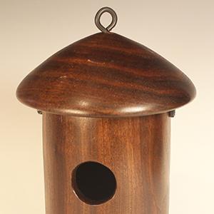 "Walnut birdhouse 11"" x 7"" (28cm x 18cm)."