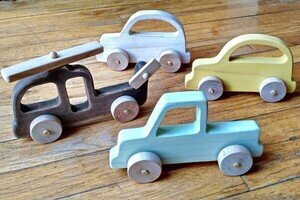 Wooden toy vehicles.