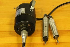 Flexible shaft grinder along with two hand pieces.