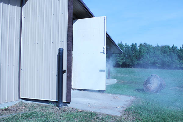 Dust being draw out of the shop through two big doors - natural ventilation #dust #control #ventilation