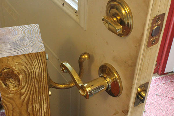 Door being propped open using the door handle.