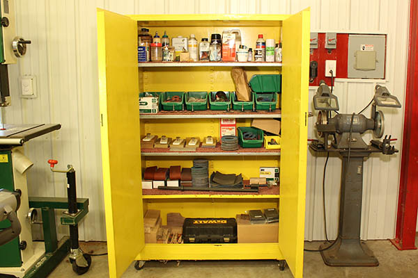 Closed storage cabinets help organize tools while also keeping dust off smaller items #cabinets #shop #storage